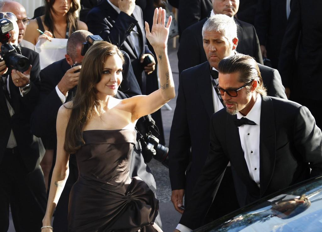 Cast member Pitt and actress Jolie arrive for the screening of the film
