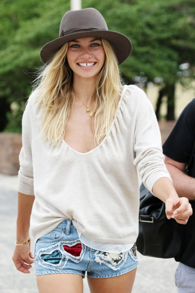 Stunning leggy supermodel Jessica Hart preps for a photo shoot at Bondi Beach wearing a low cut beige top and short shorts