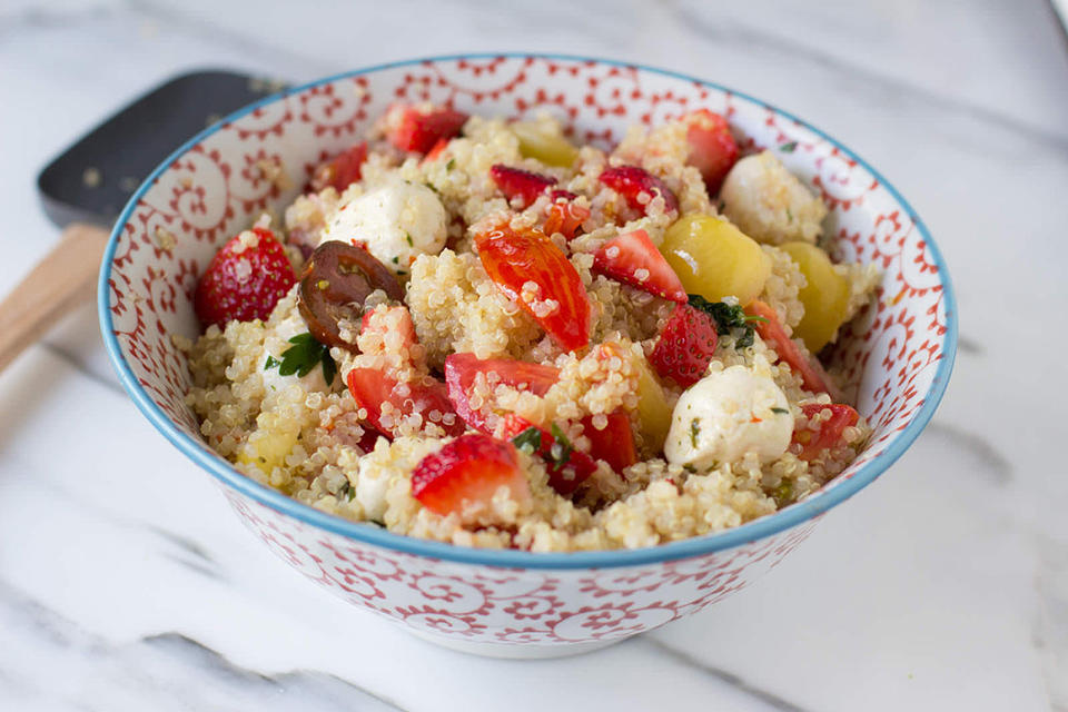 The-perfect-way-to-enjoy-your-summer-without-gobs-of-calories-heirloom-tomatoes-marinated-mozzarella-and-plump-strawberries-tossed-in-quinoa-vegetarian-recipe-ohsweetbasil.com_-5
