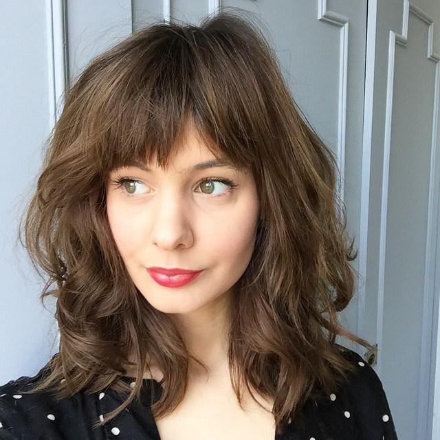 11-medium-layered-haircut-with-straight-bangs