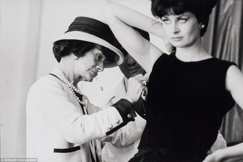 28221A2800000578-3060686-A_never_before_seen_image_of_Coco_Chanel_hard_at_work_in_her_des-m-12_1430308933984