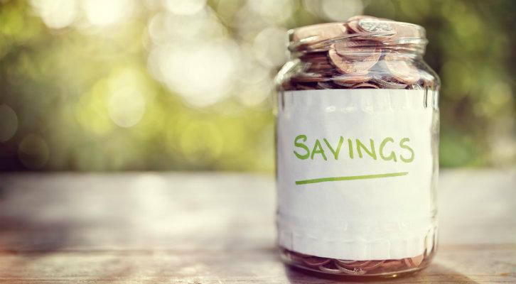 bigstock-Savings-money-jar-full-of-coin-105925046